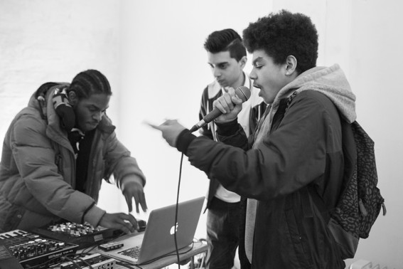 Young musicians working on electronic music