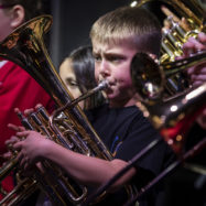 Young musicians playing brass instruments