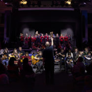 Young musicians being led by an orchestrator